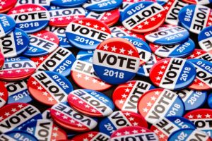 Image of Democratic vote pins.
