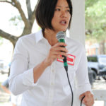 Kathy Cheng (candidate for Justice, Texas Supreme Court, Place 6) speaks at the Kyle/Buda-Area Democrats Ice Cream Social on Aug. 5 at the Kyle City Square Park gazebo.  Photo by Christopher Paul Cardoza
