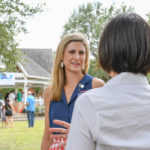 Chari Kelly an Kathy Cheng (candidate for Justice, Texas Supreme Court, Place 6) speaks at the Kyle/Buda-Area Democrats Ice Cream Social on Aug. 5 at the Kyle City Square Park gazebo.  Photo by Christopher Paul Cardoza